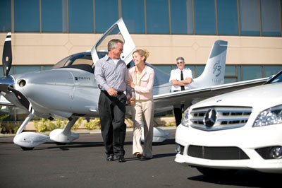 couple getting off charter flight